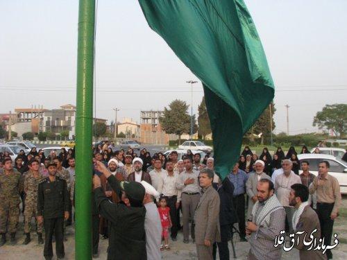 گزارش تصویری از برافراشته شدن پرچم بارگاه امام رضا (ع) در آق قلا