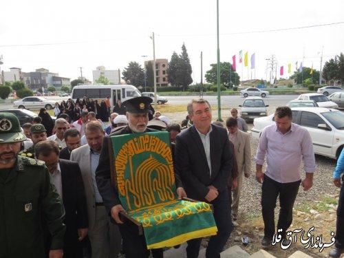 آئین استقبال از کاروان خادمین حرم رضوی در شهرستان آق قلا برگزار شد