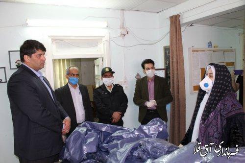 فرماندار و رئیس ستاد مقابله با کرونا از واحد تولیدی لباس گان شهر آق قلا بازدید بعمل آورد